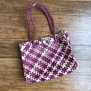 Handbags - Magenta/tan woven straw handbag